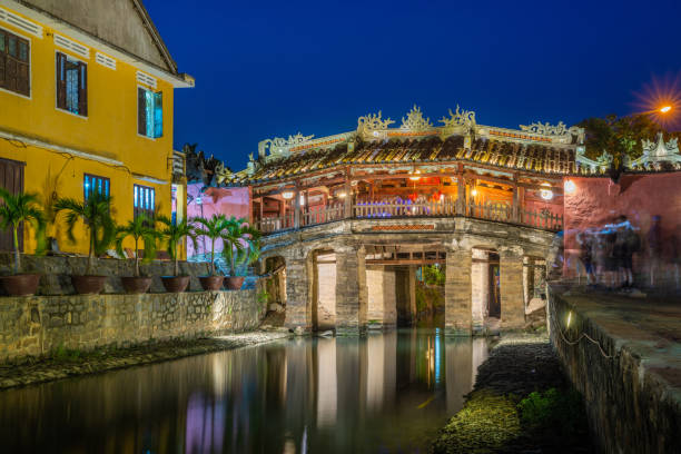 Cau Chua Pagoda, Japanese Covered ancient Bridge and River in Street in Old city of Hoi An stock photo