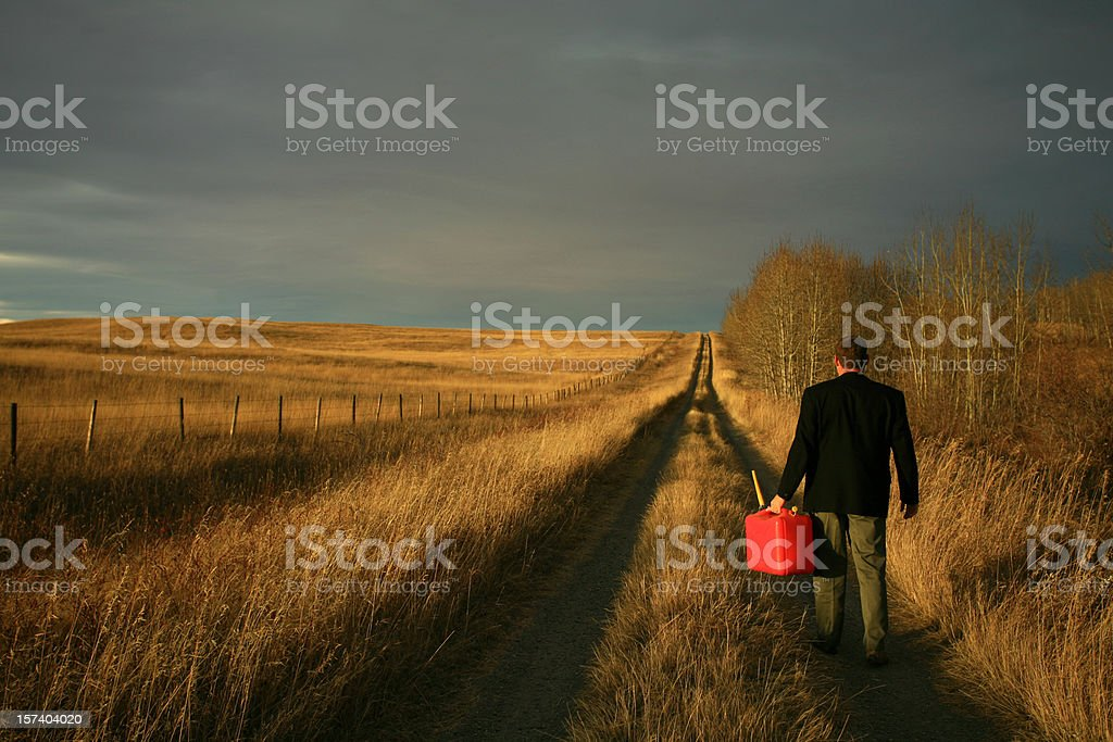 Cauacisan Businessman Running Out of Gas in Country stock photo