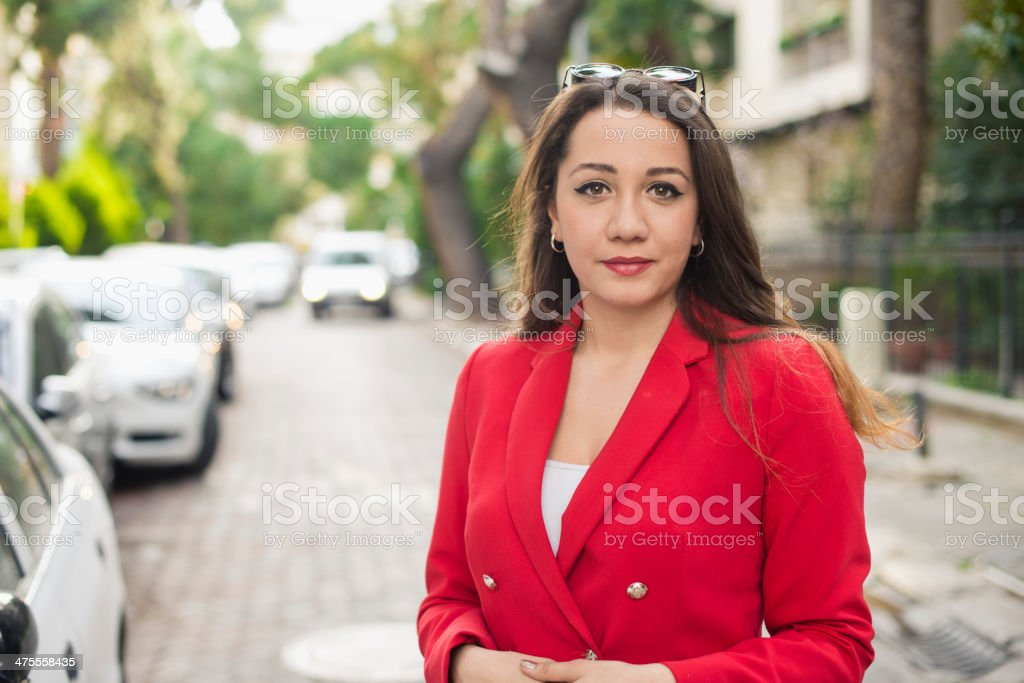 caucaian young woman in the street. stock photo