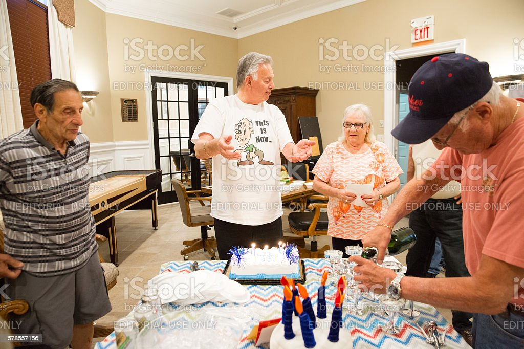 Caucasian 80 Year Old Man Celebrates His Birthday With Friends Royalty Free Stock Photo