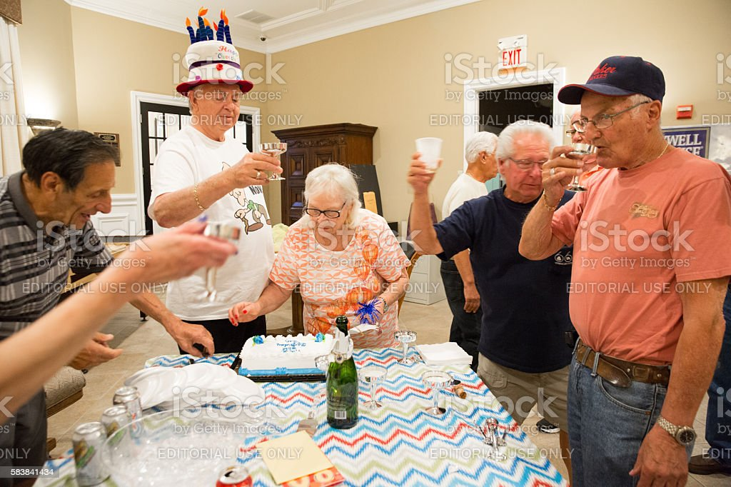 Caucasian 80 Year Old Man Celebrates His Birthday With Friends