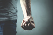 istock Caucasian angry and aggressive man threatening with fist. 1009355852