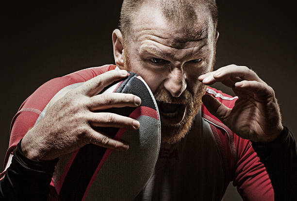 caucasian bearded redhead adult male rugby player shouting aggressively - rugby fotografías e imágenes de stock
