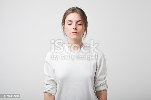 Caucasian beautiful woman with her eyes closed. Concept of no emotional face