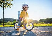 istock Caucasian Boy Driving Balance Bike Outdoors 1278010213