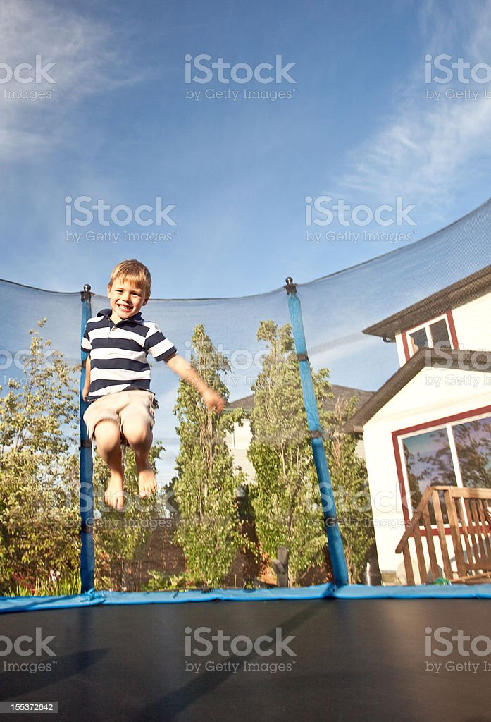 Caucasian Boy Jumping on Trampoline royalty-free stock photo