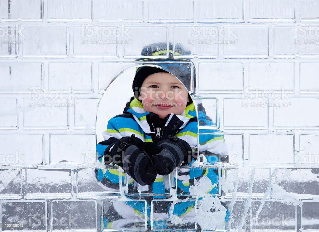 Caucasian Boy Looking Through Ice Sculpture stock photo