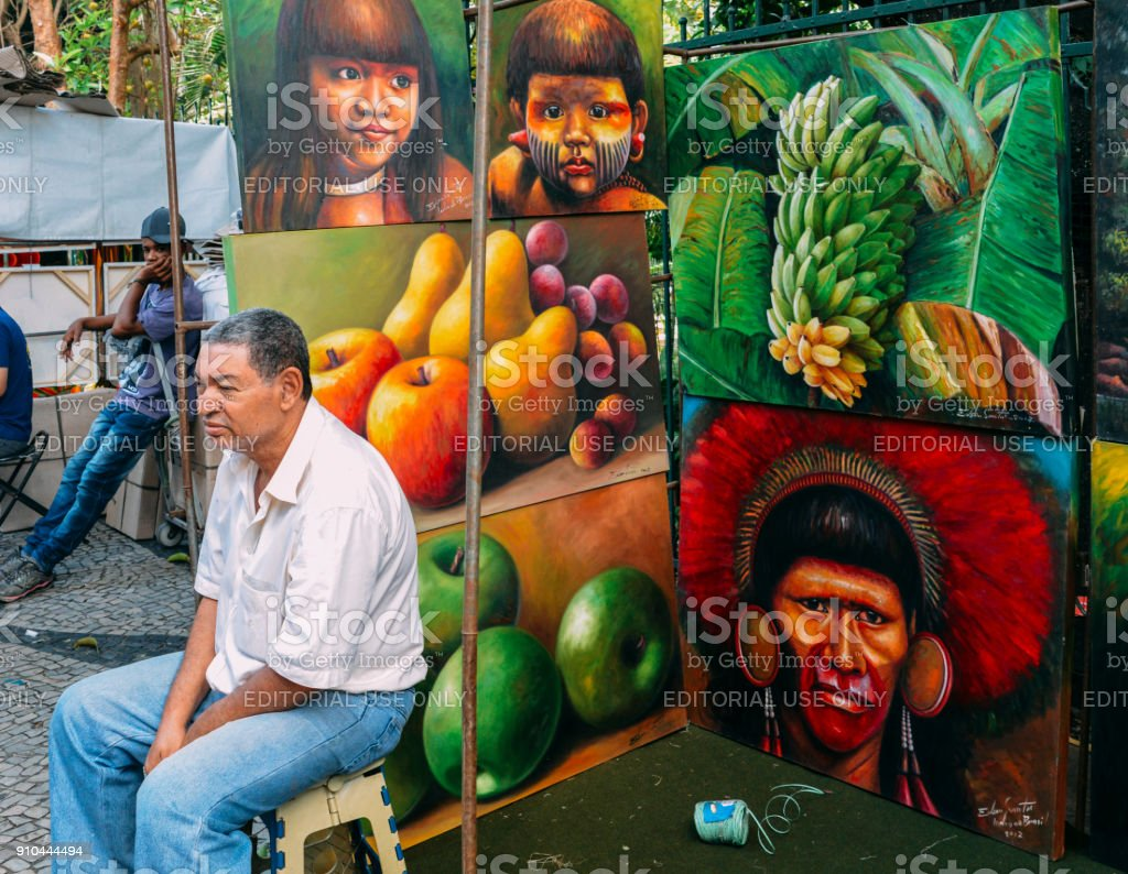 Caucasian Brazilian man selling local Braziilan scenes illustrat stock photo