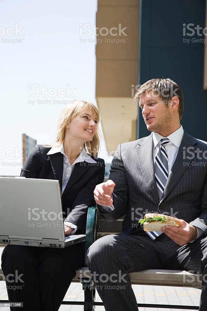 Caucasian business people having discussion royalty-free stock photo