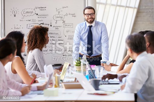 504987926 istock photo Caucasian Businessman Leading Meeting At Boardroom Table 504990322