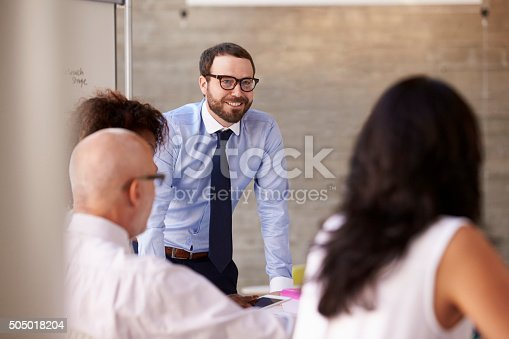 istock Caucasian Businessman Leading Meeting At Boardroom Table 505018204