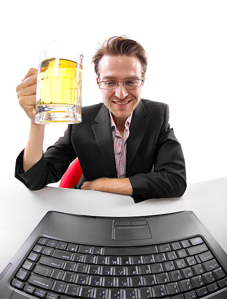 Caucasian Businessman Taking a Break After Work with Beer stock photo