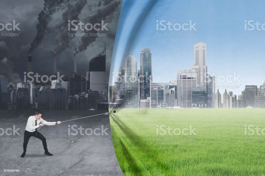 Caucasian businessman tries to save environment stock photo