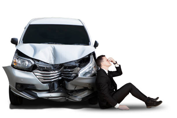 Caucasian businessman with broken car