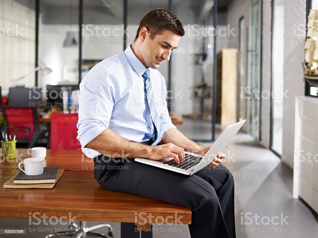 caucasian businessman working in office stock photo