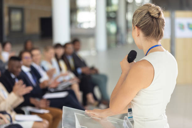 Caucasian businesswoman doing a speech in conference room stock photo