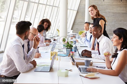istock Caucasian Businesswoman Leading Meeting At Boardroom Table 504933788