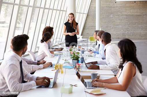 istock Caucasian Businesswoman Leading Meeting At Boardroom Table 504933856