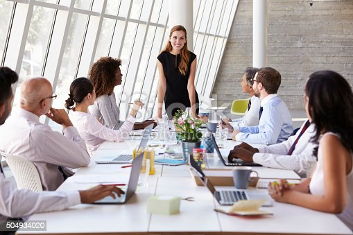 istock Caucasian Businesswoman Leading Meeting At Boardroom Table 504934020