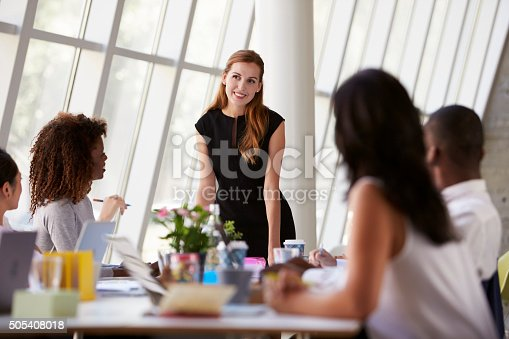 istock Caucasian Businesswoman Leading Meeting At Boardroom Table 505408018
