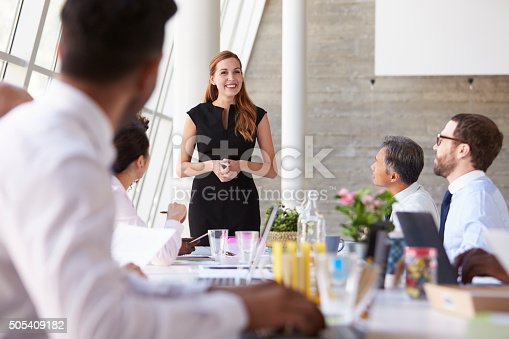 istock Caucasian Businesswoman Leading Meeting At Boardroom Table 505409182