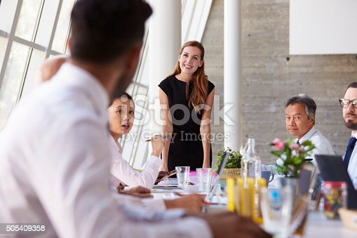 istock Caucasian Businesswoman Leading Meeting At Boardroom Table 505409358