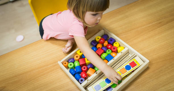 Caucasian child playing in kindergarten stock photo