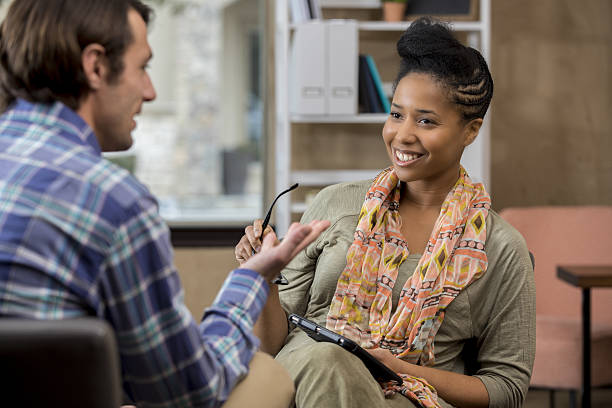 caucasian counseling patient talks with counselor - psychiatrie und psychotherapie stock-fotos und bilder