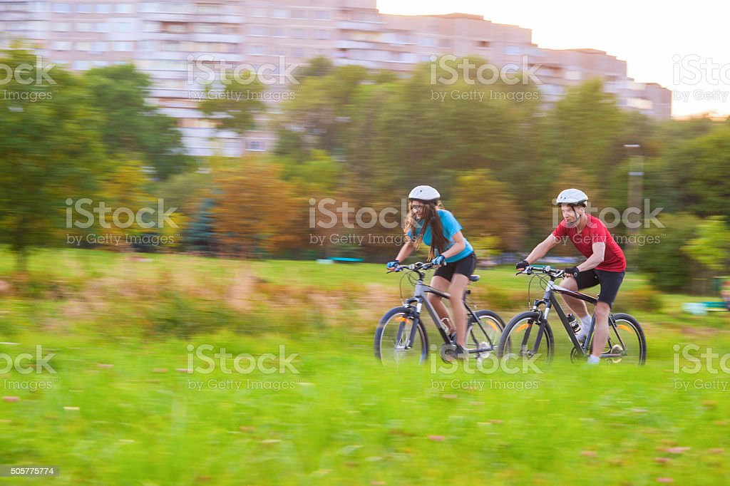 Caucasian Couple Having a Sppedy Bicycle Trip stock photo