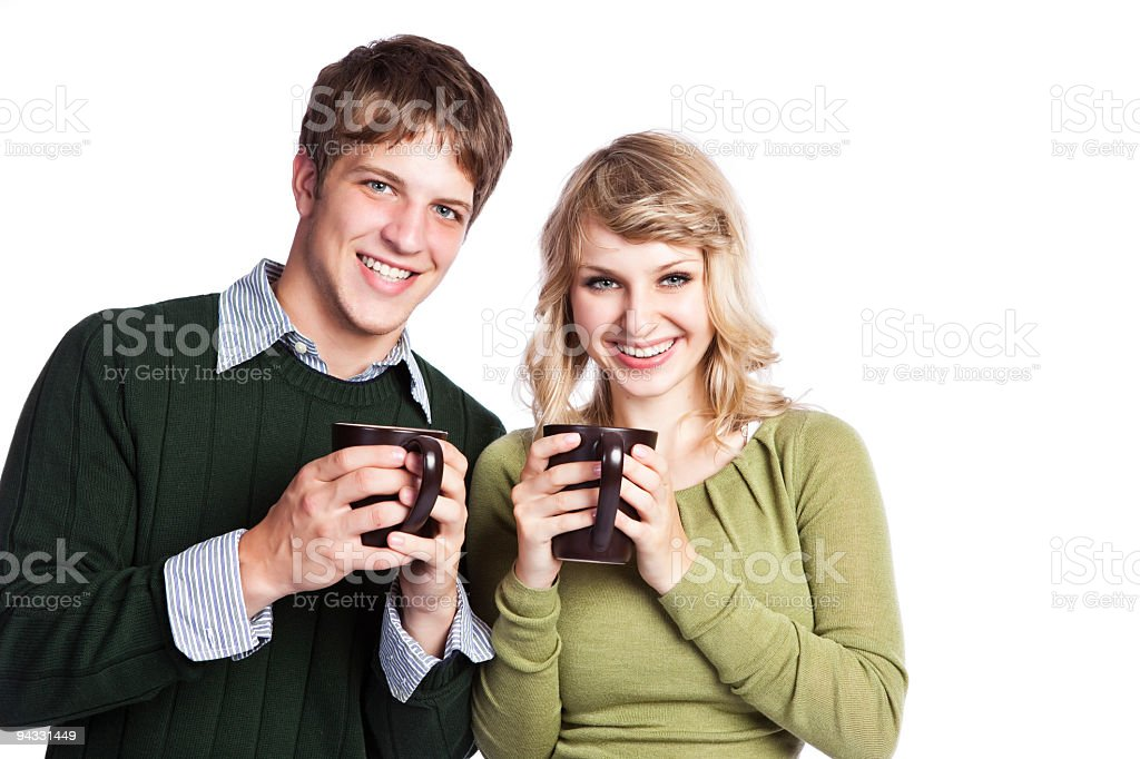 Caucasian couple holding coffee cups royalty-free stock photo