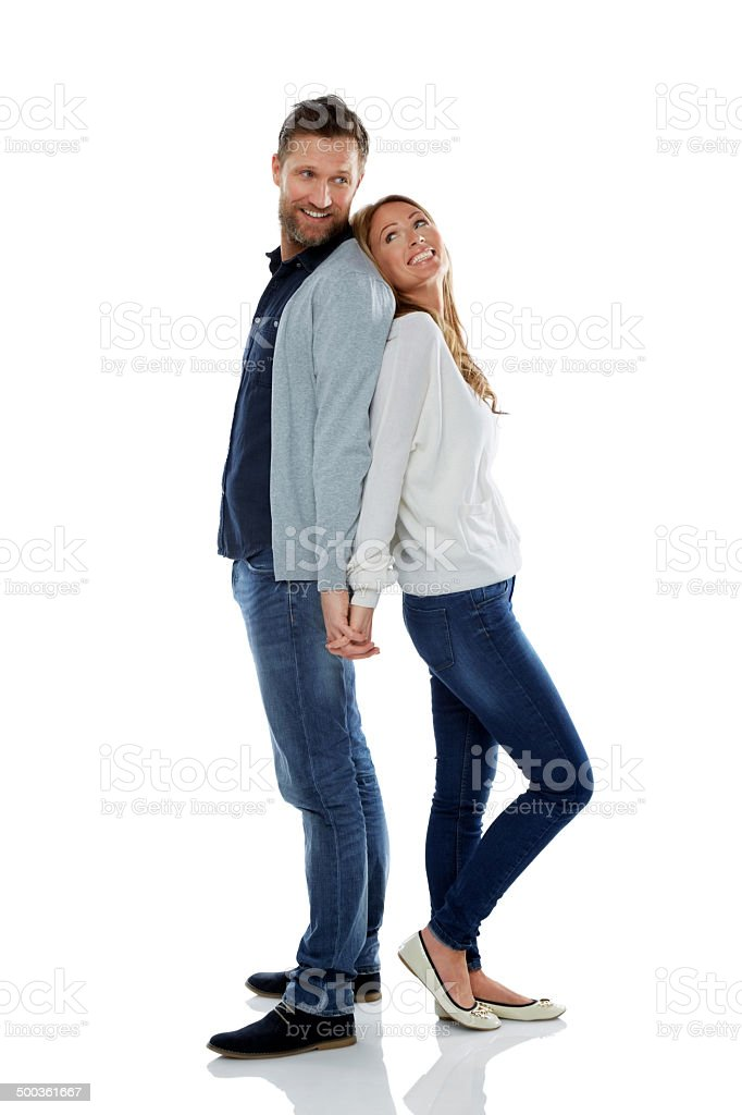 Caucasian couple standing on white stock photo