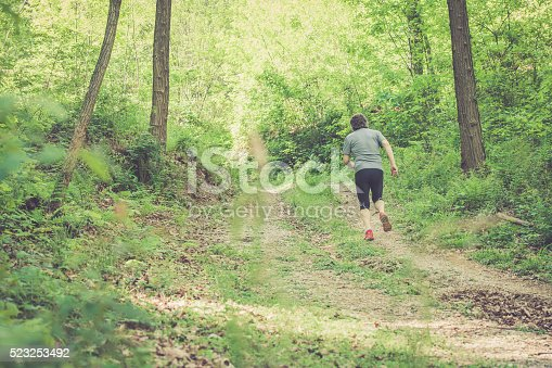 636248376 istock photo Caucasian elderly man running up in forest - rear view 523253492