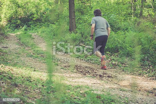 636248376 istock photo Caucasian elderly man running up in forest - rear view 523256222