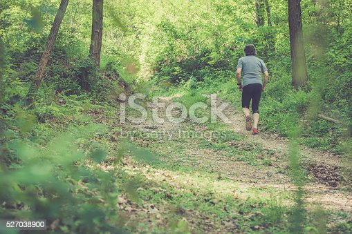 636248376 istock photo Caucasian elderly man running up in forest - rear view 527038900