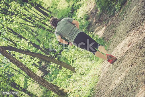 636248376 istock photo Caucasian elderly man running up in the forest 525487288