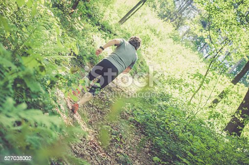 636248376 istock photo Caucasian elderly man running up in the forest 527038002