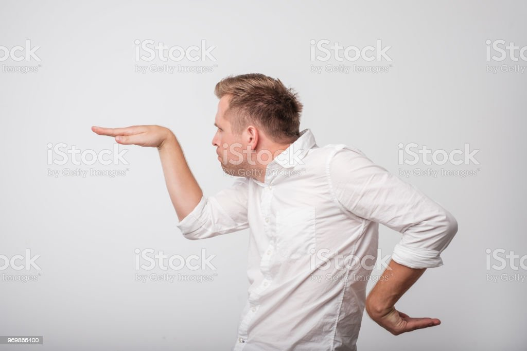 Caucasian excited young man raising his hands in a side view as he dancing. foto stock royalty-free