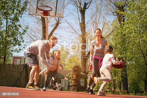 istock Caucasian family playing basketball together. Happy family spending free time together. 691524518