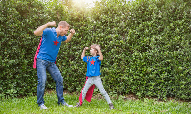 caucasian father and daughter child girl playing in the spring or summer green park outdoors. happy family love together single dad lifestyle father's day holiday concept - fathers day stock photos and pictures