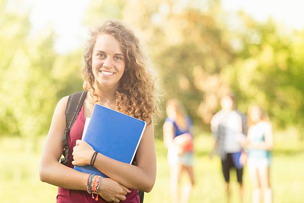 Caucasian female college student outdoors stock photo