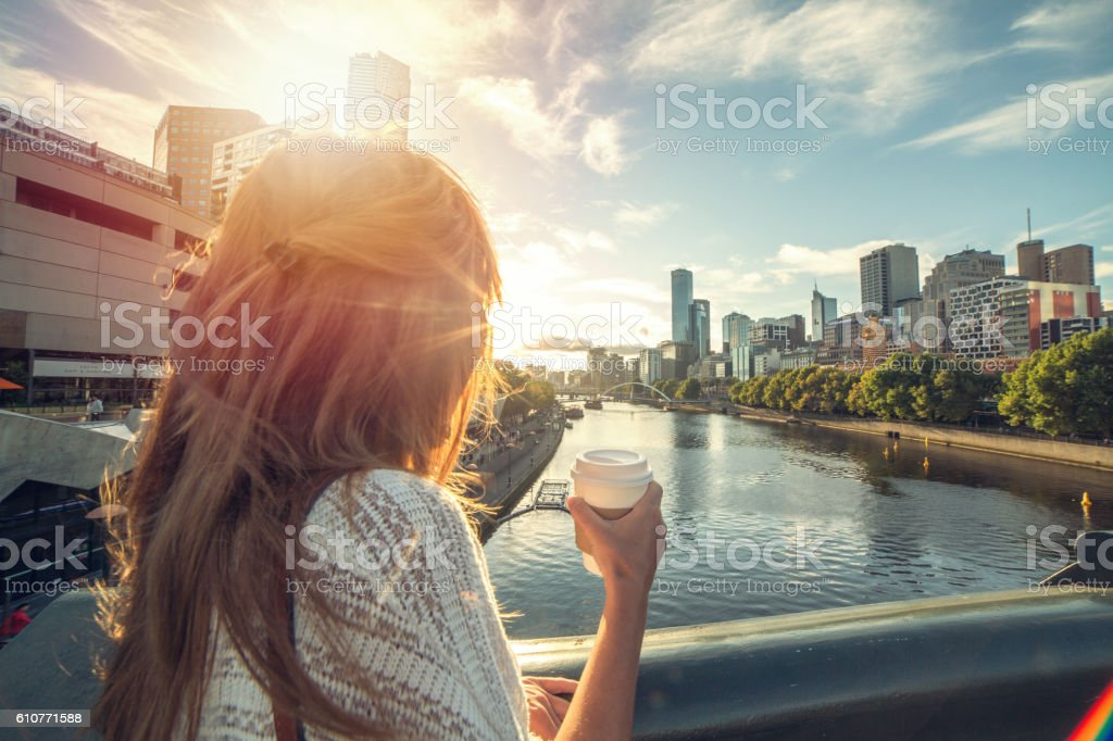Caucasian female enjoys city life in Melbourne stock photo