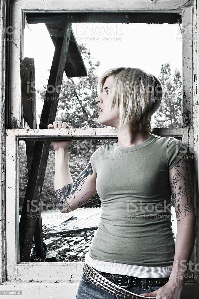 Caucasian Female Near Window royalty-free stock photo