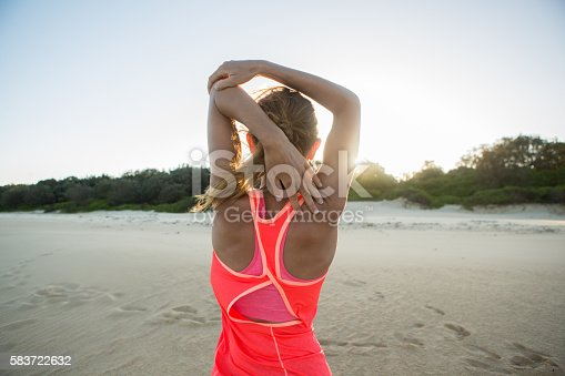 887354516istockphoto Caucasian female stretching body after jogging 583722632