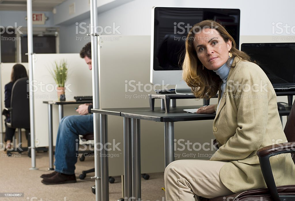 Caucasian forty something woman at her office royalty-free stock photo
