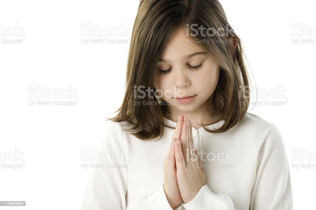 caucasian Girl Praying with Eyes Closed stock photo