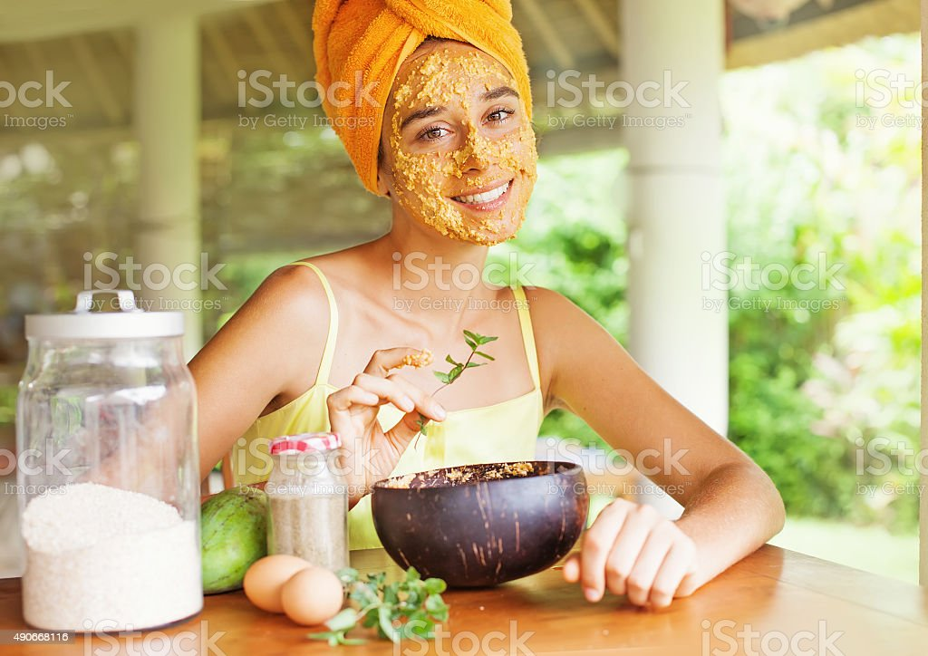 Caucasian girl with natural mask her face stock photo