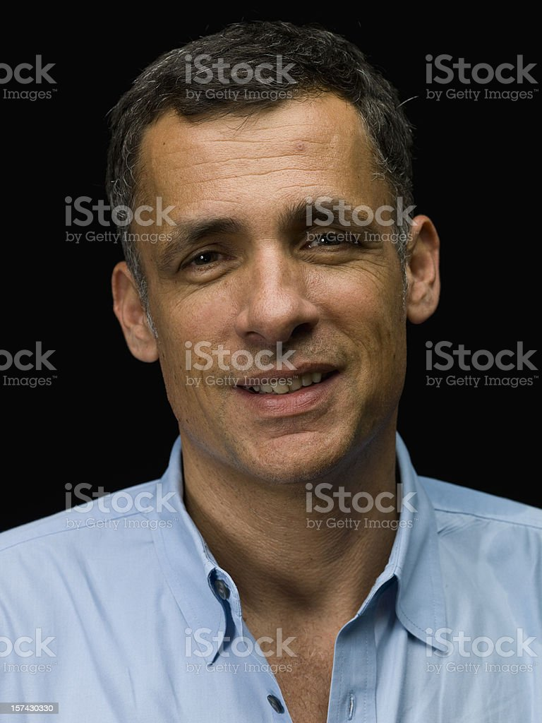 Caucasian grey haired male smiling. stock photo