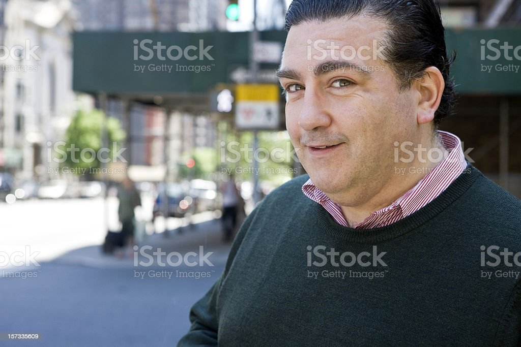 Caucasian Heavy Set Italian Man Portrait on City Sidewalk, Copyspace stock photo