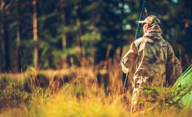 Caucasian Hunter in the Wild Caucasian Hunter in the Wild. Men in His 30s with Fishing Rod in Hand. hunter stock pictures, royalty-free photos & images
