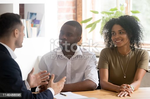 689401592 istock photo Caucasian lawyer or financial advisor consulting young african couple 1146488595